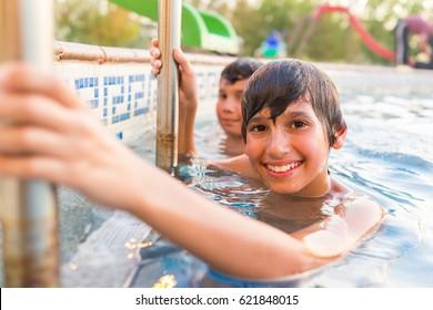 Child having fun on summer swimming pool