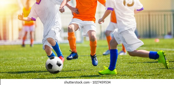 Child Having Fun Playing Soccer Game. Youth Soccer Match for Kids. Outdoor Football Tournament on School Pitch. Young Footballlers Running the Ball