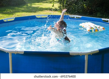 Child having fun in rubber swimming pool.