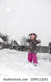 child having a snowball fight