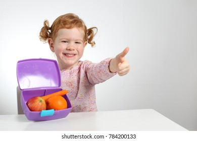 A Child with healthy lunch box fruit snack