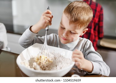child helps mom prepare delicious and healthy breakfast