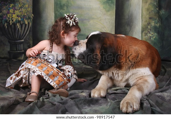 Child and Her Saint Bernard Puppy Dog