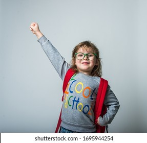 Child hero in school education. Cool school. Funny little kid with backpack