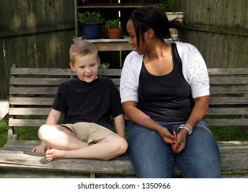 A child and his babysitter talking.