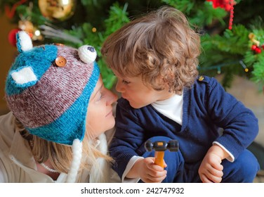 Child and his mam close to a Christmas tree