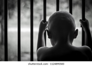 child hold cage with sad and hopeless,Victims of human trafficking,Violence against children; International Anti-Trafficking Day
