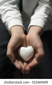 Child hold in hands heart. Text hope. �?xpectation concept