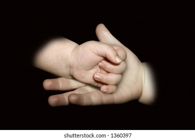 A child holding a babies hand