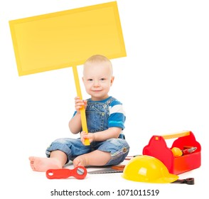 Child holding Banner Sign, Baby Boy Playing Toys Tools, Kid sitting with Blank Board Isolated over White Background, infant one year old