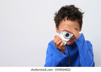 child holding camera with white background stock photo