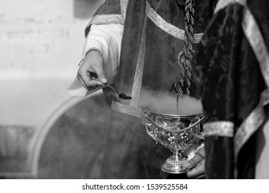 Child holding a censer in a procession