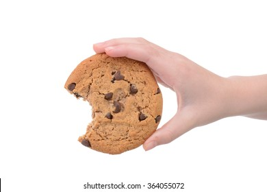 child holding a chocolate chip cookie isolated white background