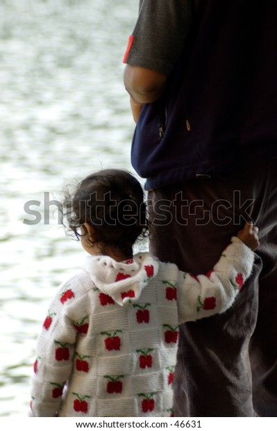 Child holding dad