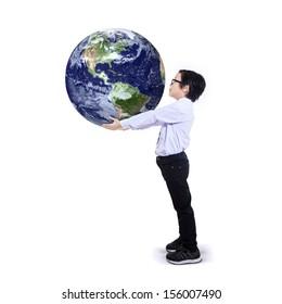 Child holding the earth isolated on white background. Earth image courtesy o NASA
