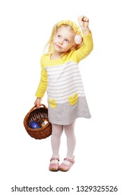 Child holding and easter egg with easter basket on white background