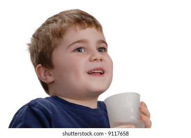 Child holding a glass of water, isolated on white