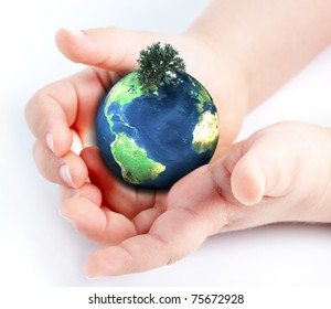 child holding globe in hands