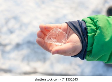 child holding ice cubes - winter