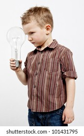 A child holding a large bulb.