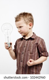 A child holding a large bulb. He is enraged because he did not have any interesting idea.