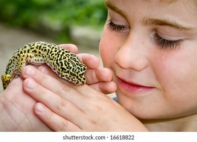 Child holding Leopard Gecko Lizard