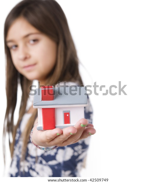 Child holding a model home
