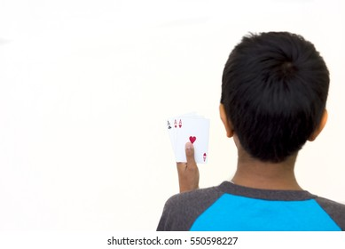 Child holding poker cards on a white background