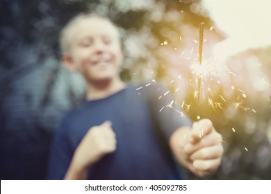 Child holding a sparkler,  Instagram toned image