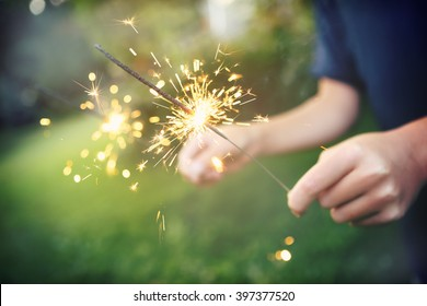 Child holding sparklers