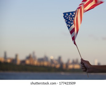 A child holds an American flag on a boat on the Hudson river in New York on the 4th of July. - New York City, United States of America
