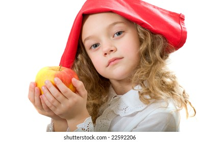 The child holds an apple in hands. Isolated on a white background