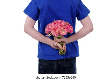 A child holds flowers behind his back