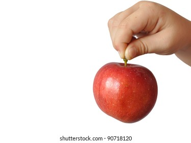 A child holds a large red apple fruit stem, in isolation