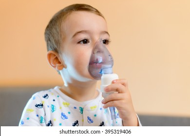 Child holds a mask vapor inhaler