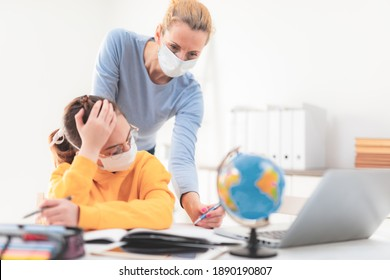 Child home studying education, homeschooling, with private tutor mother with protective mask in the time of viruses, flu and seasonal pandemic.