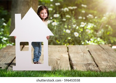Child and house on the park.