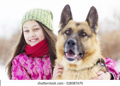child hugging a dog, winter walk