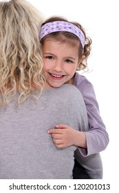 Child hugging a woman