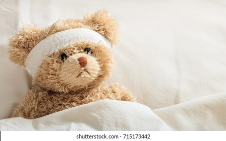 The child is hurt.Teddy bear with bandage in the hospital, space for text