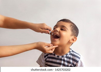 Child immunization with little drop in clinic. Doctor providing immunization vaccines for the immune system of infant. Child's Immunization, Children's Vaccination, Health conception.