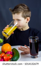 the child indulges in at the table,playing with vegetables.