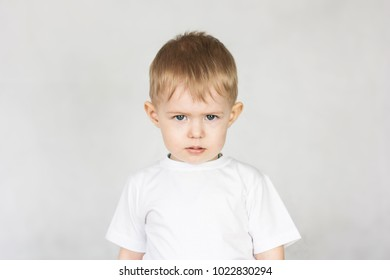 child insult concept. childish issues. boy in white on a white background