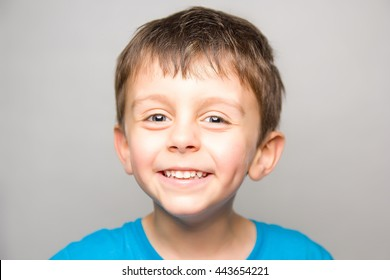 Child in joy smilling at camera