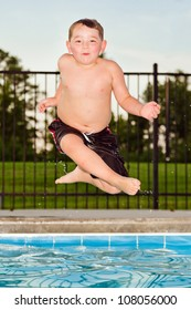 Child jumping into pool while going on swimming outing during summer