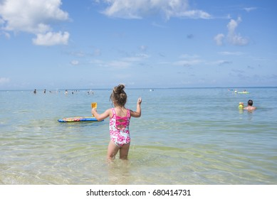 Child jumping in ocean
