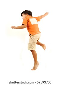 Child jumping on white background with copy space on his back
