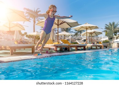 A child jumps into the pool. Egypt, Sharm El-Sheikh