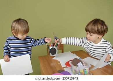 Child, kid engaged in arts and crafts activity, sharing and playing nice together