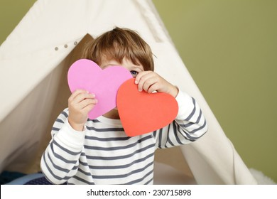 Child, kid, engaged in a Valentine's Day arts and crafts activity
